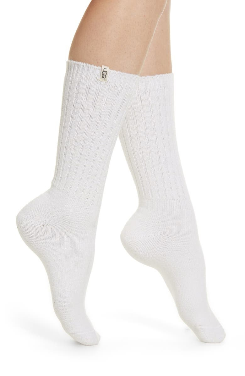 A model wears the white socks