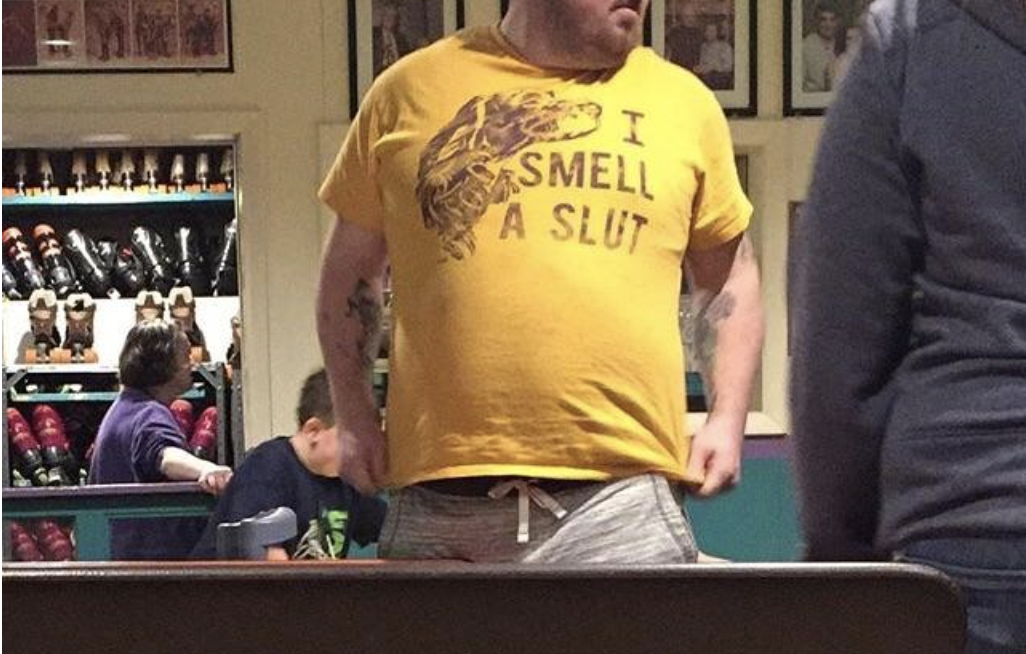 A man's shirt reads I smell a slut