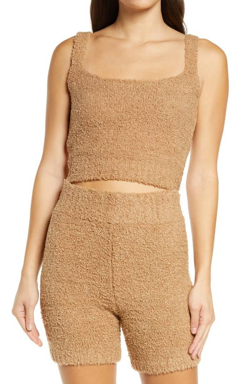 A model wears the top in tan