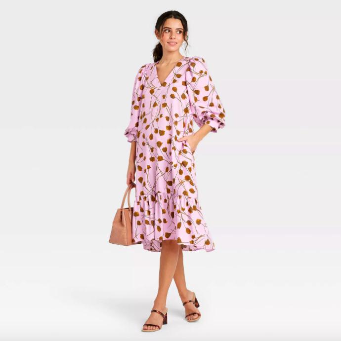 A model wearing the dress in purple