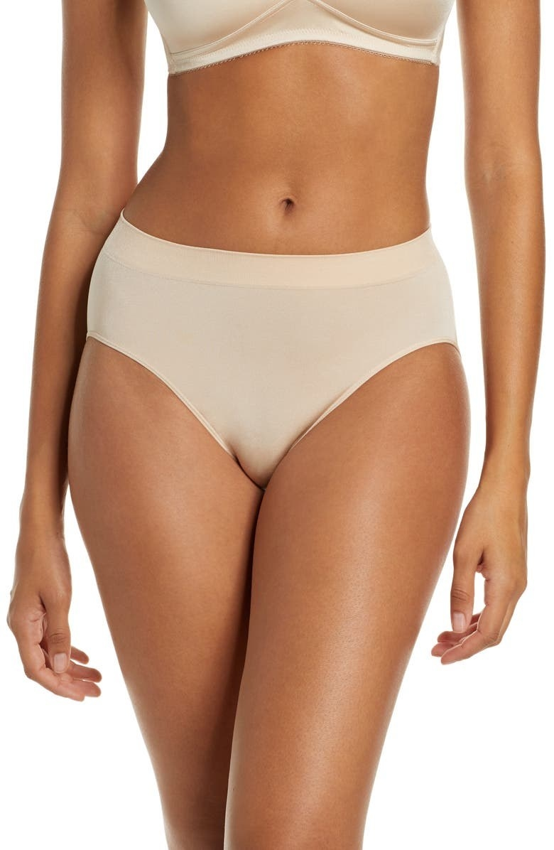 A model wears the panties in tan