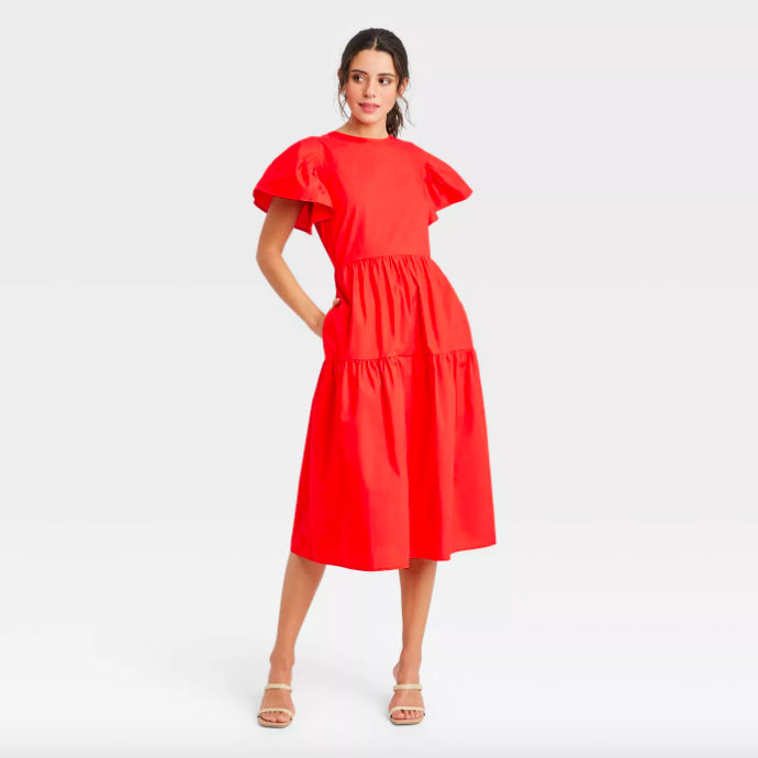 A model wearing the dress in dark red