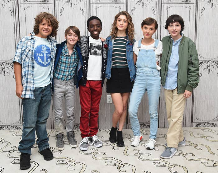 The young cast posing for a photo together