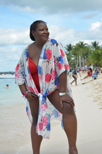 Reviewer wearing cardigan as beach cover up