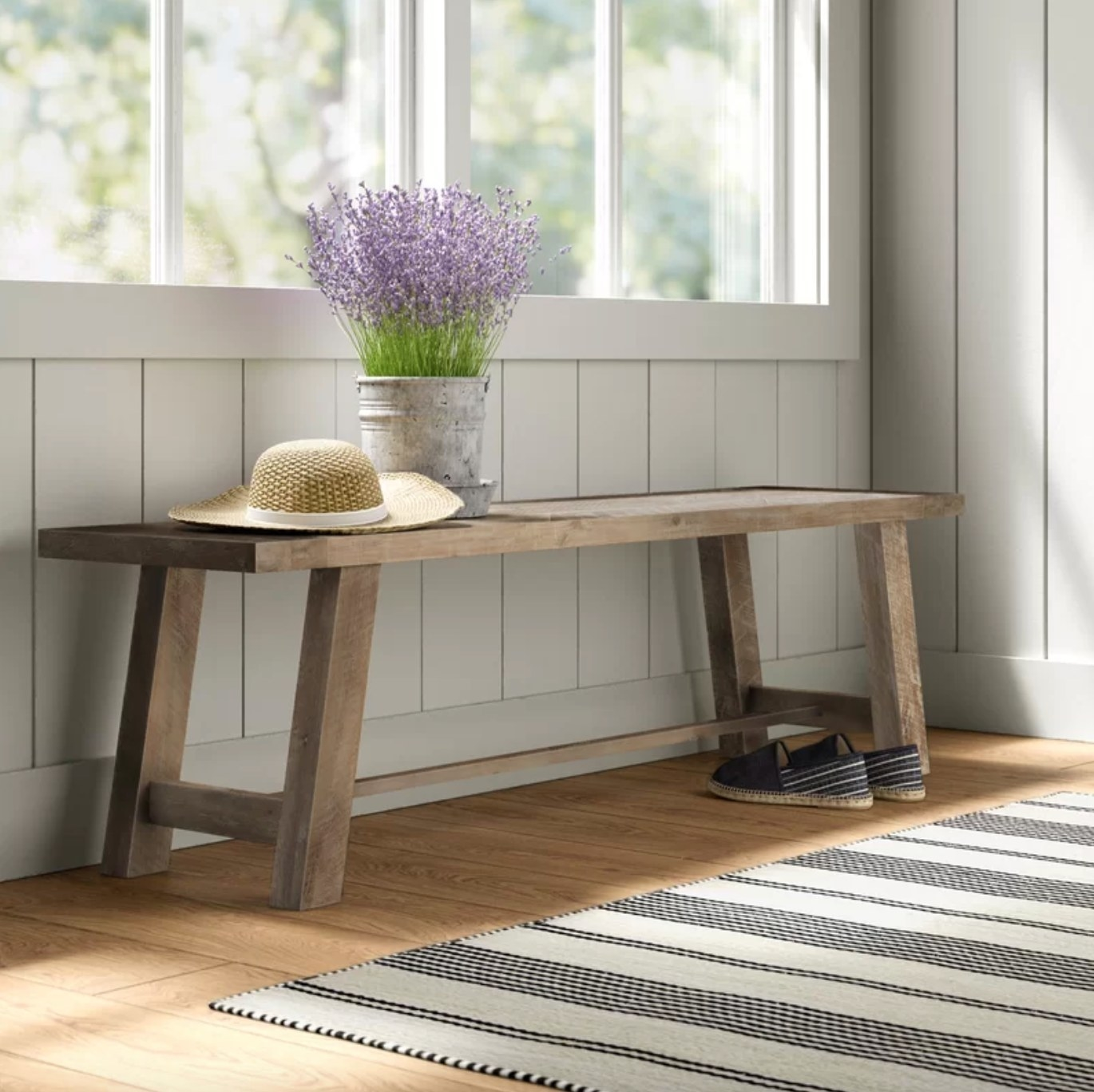 The wood bench in weathered natural finish