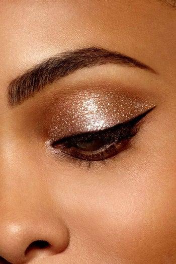 golden glitter on model