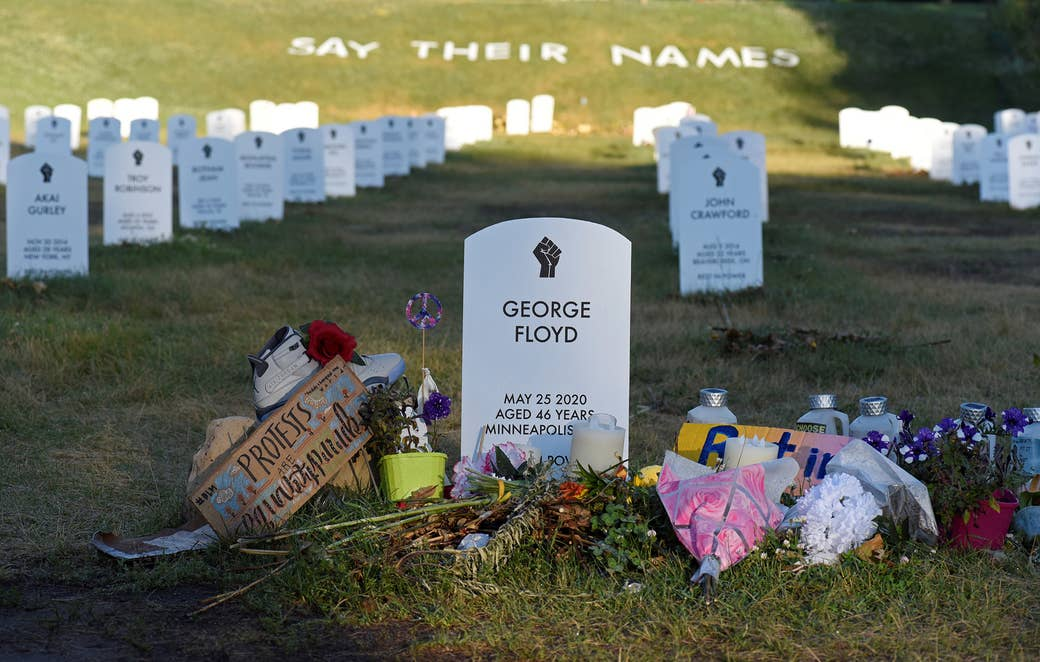 Flowers are placed at a tombstone engraved with George Floyd's name and date of death