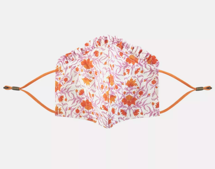 The floral print mask laid out