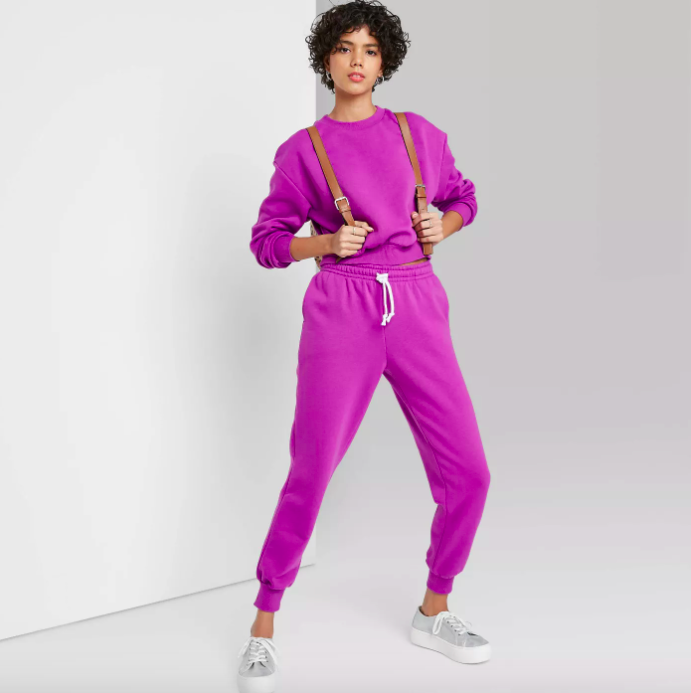 A model wearing the matching set in purple