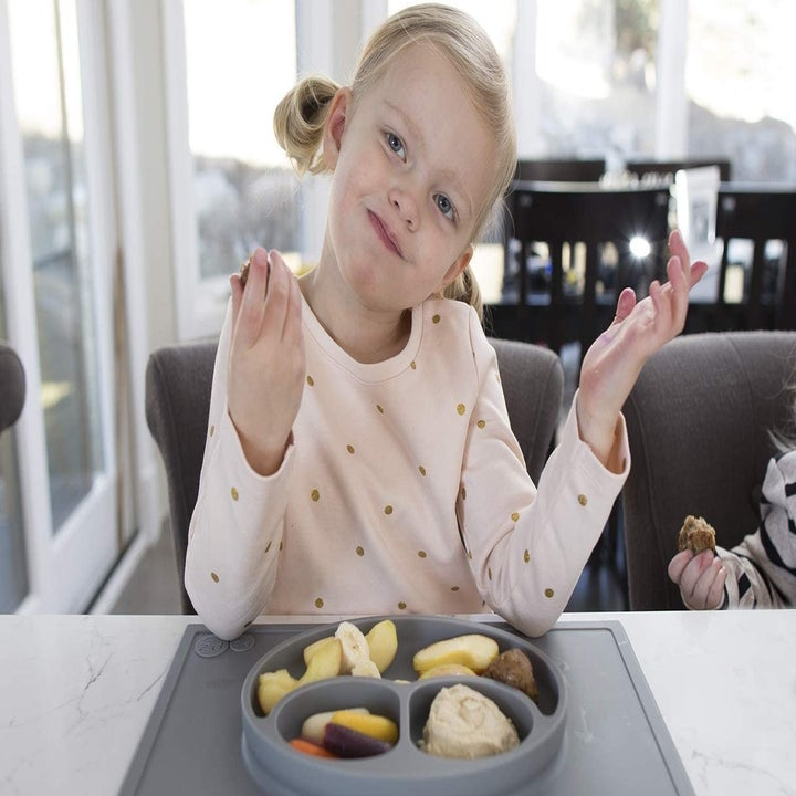 Toddler eating on the kitchen counter