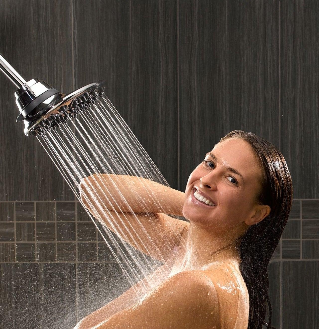 a model showers under the RainFall shower head
