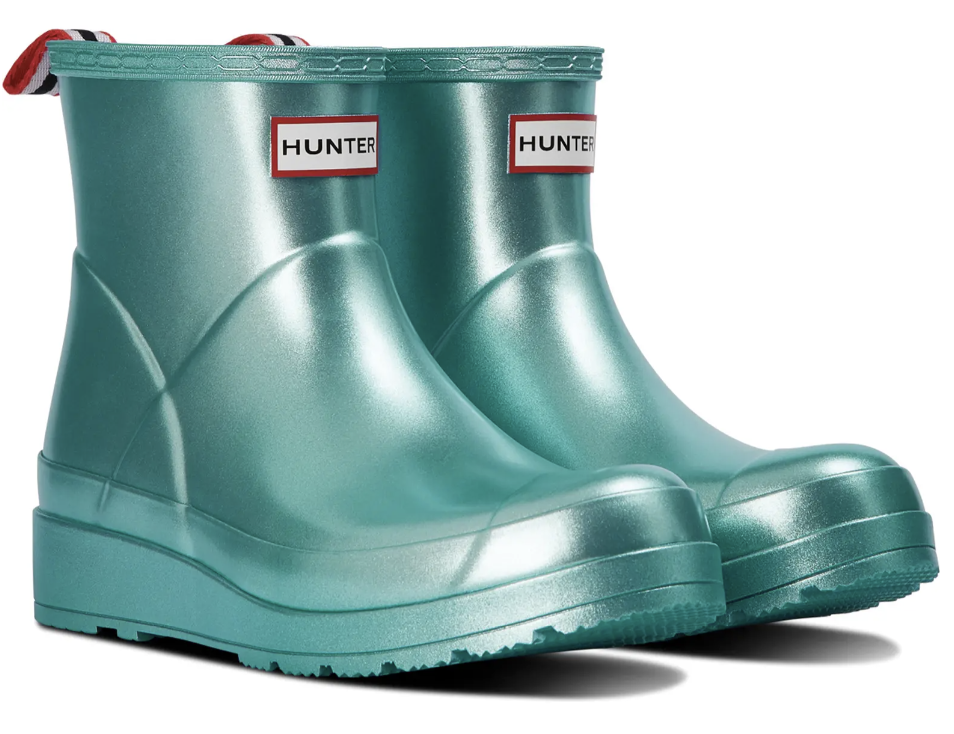 ankle height slight wedge rain boots in metallic aqua color with loop at ankle