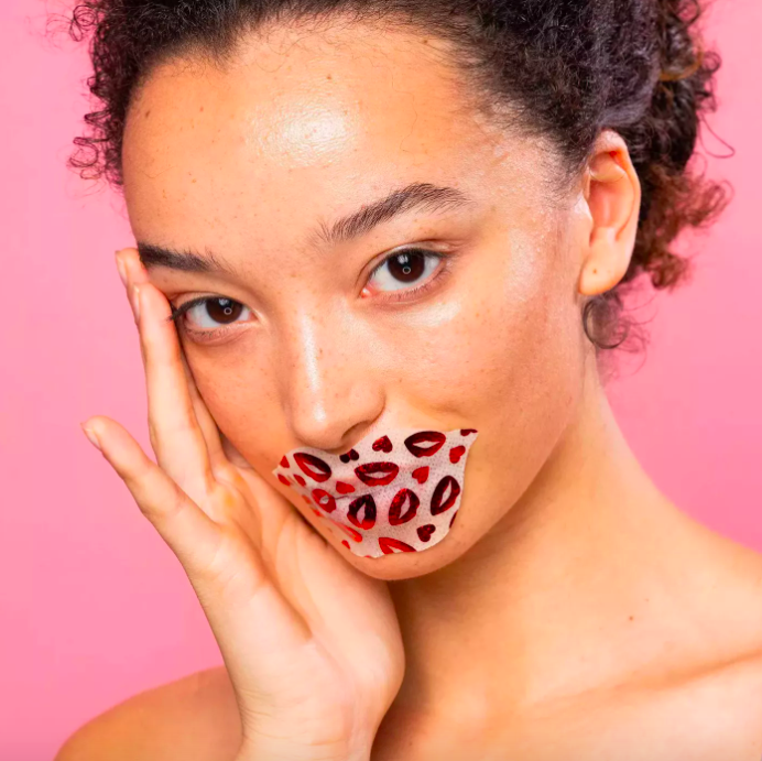 A model with the lip mask over her mouth