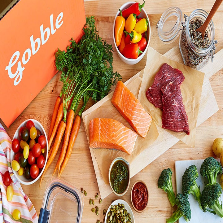 a Gobble box with salmon, carrots, and other produce