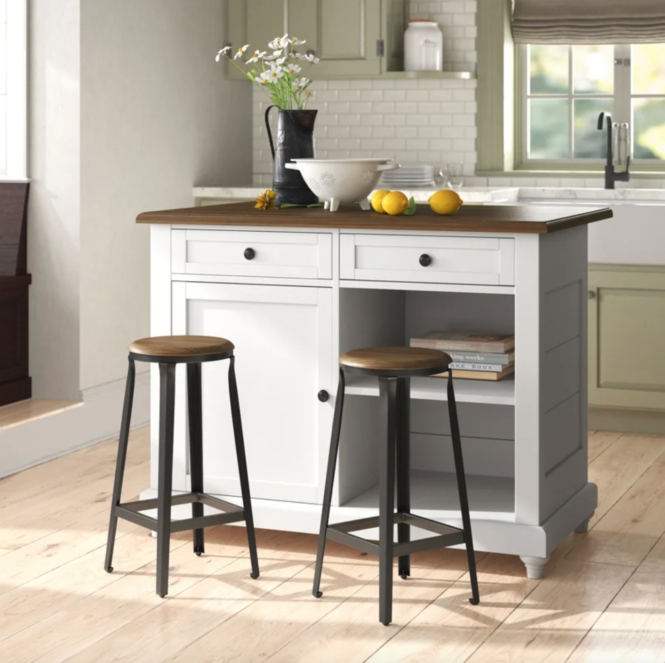 The kitchen island set in white with two stools with black iron legs