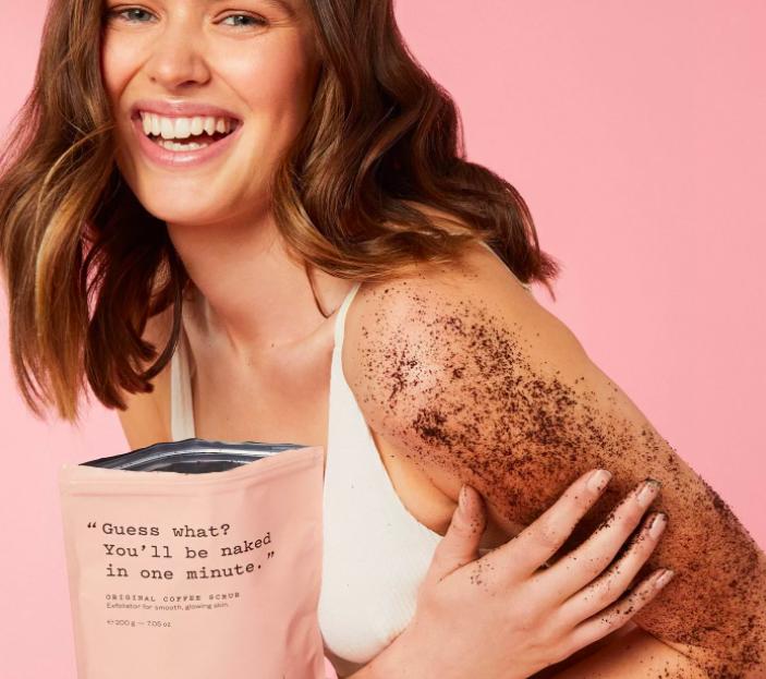 A model rubbing the scrub on her arm
