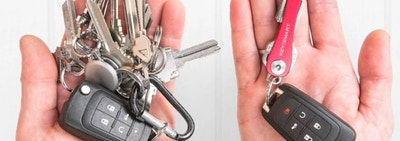 Hand holding a keyring cluttered with keys and then another hand holding a keyring with all keys organized into slim red tool