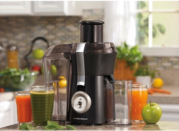 The juicer, which has a large, clear area on the side that separates out peels and scraps