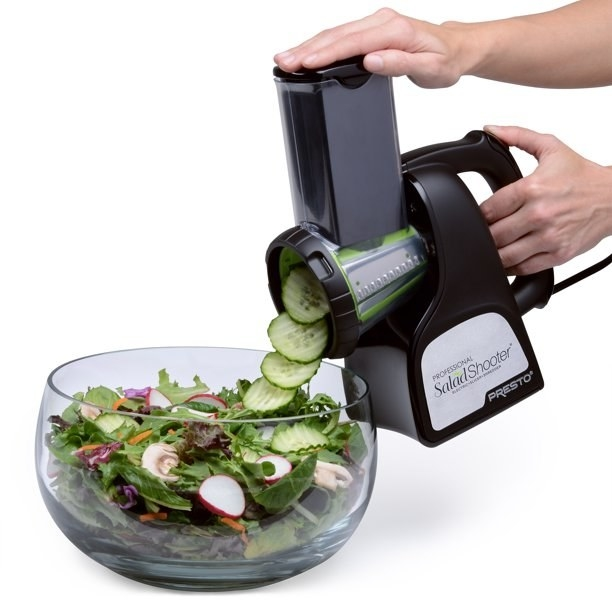 The salad shooter, which has a chute to place veggies or cheese into, and a funnel that the sliced food come out of