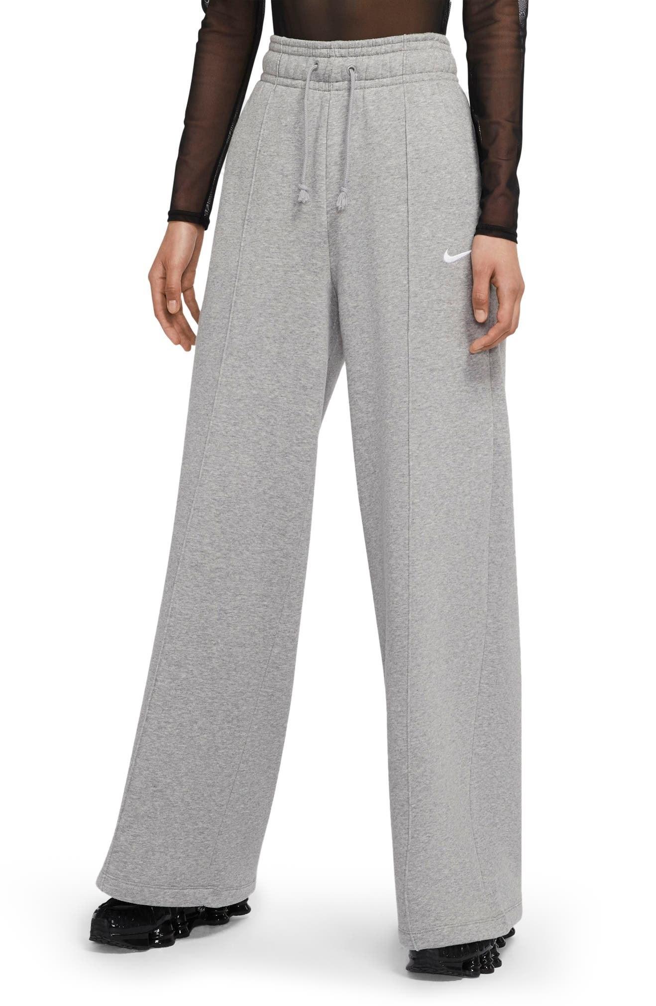 A model wears the pants in gray