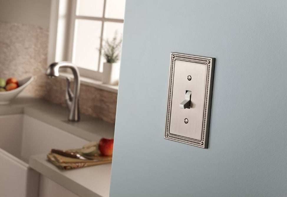a franklin brass classic beaded nickel switch plate over a light switch in a kitchen