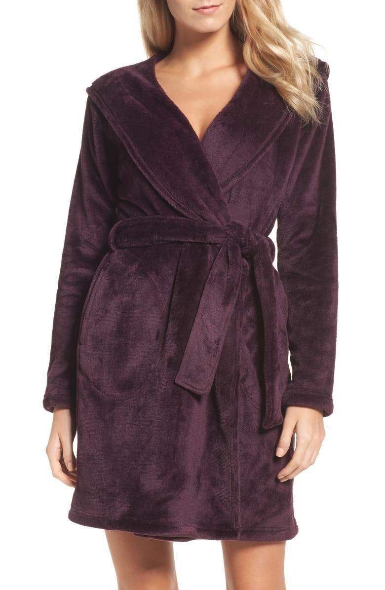 A model in the robe in dark purple