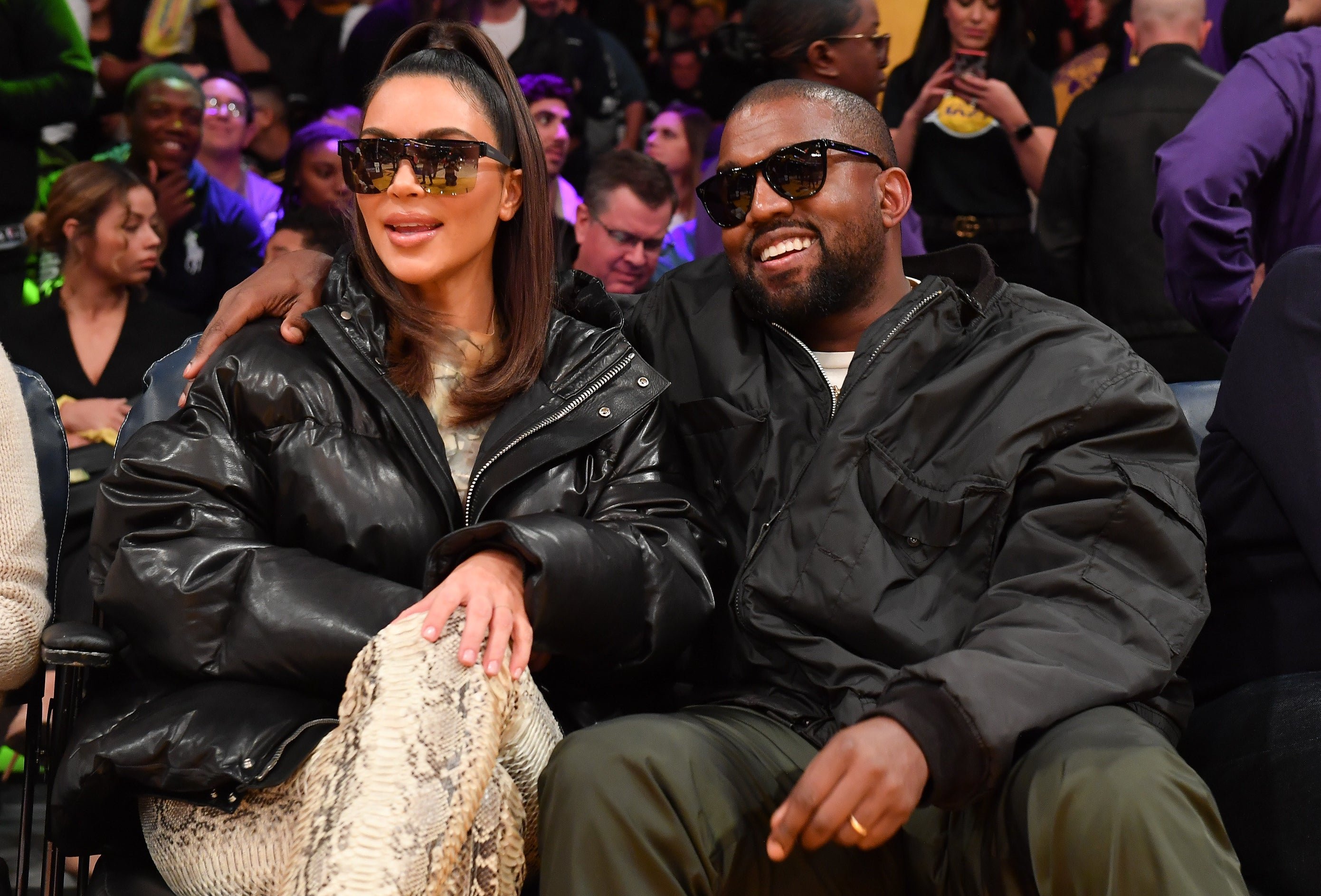 Kim and Kanye sit next to each other at a basketball game