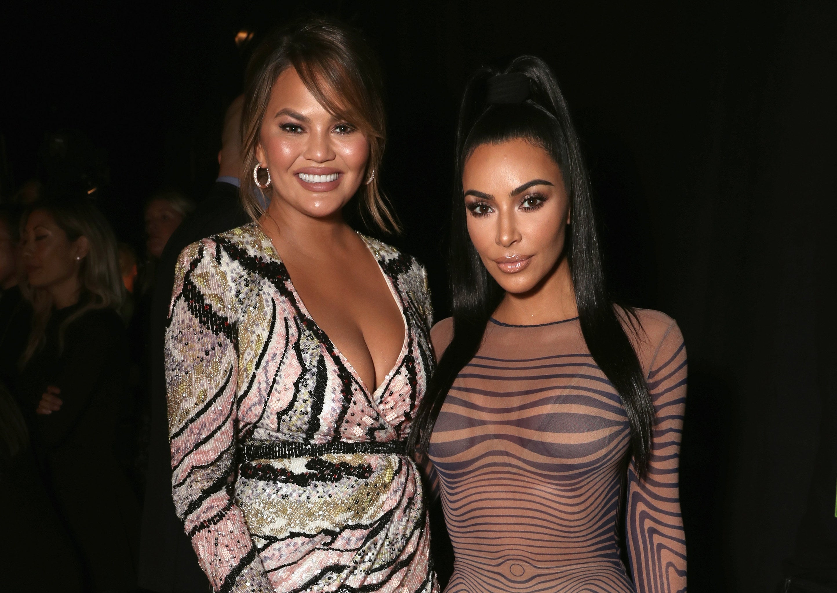 Chrissy and Kim pose together