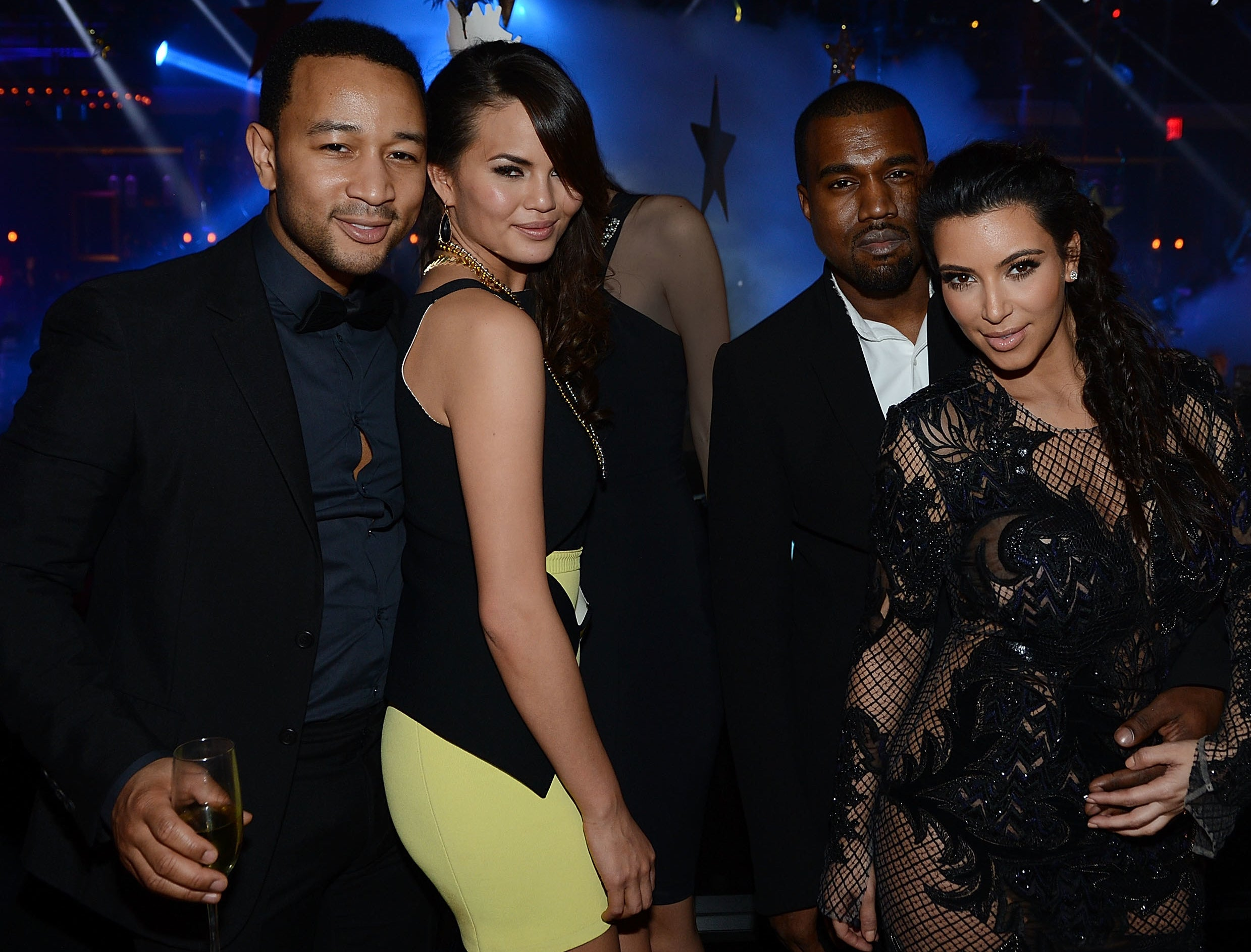 The two couples pose together at an event