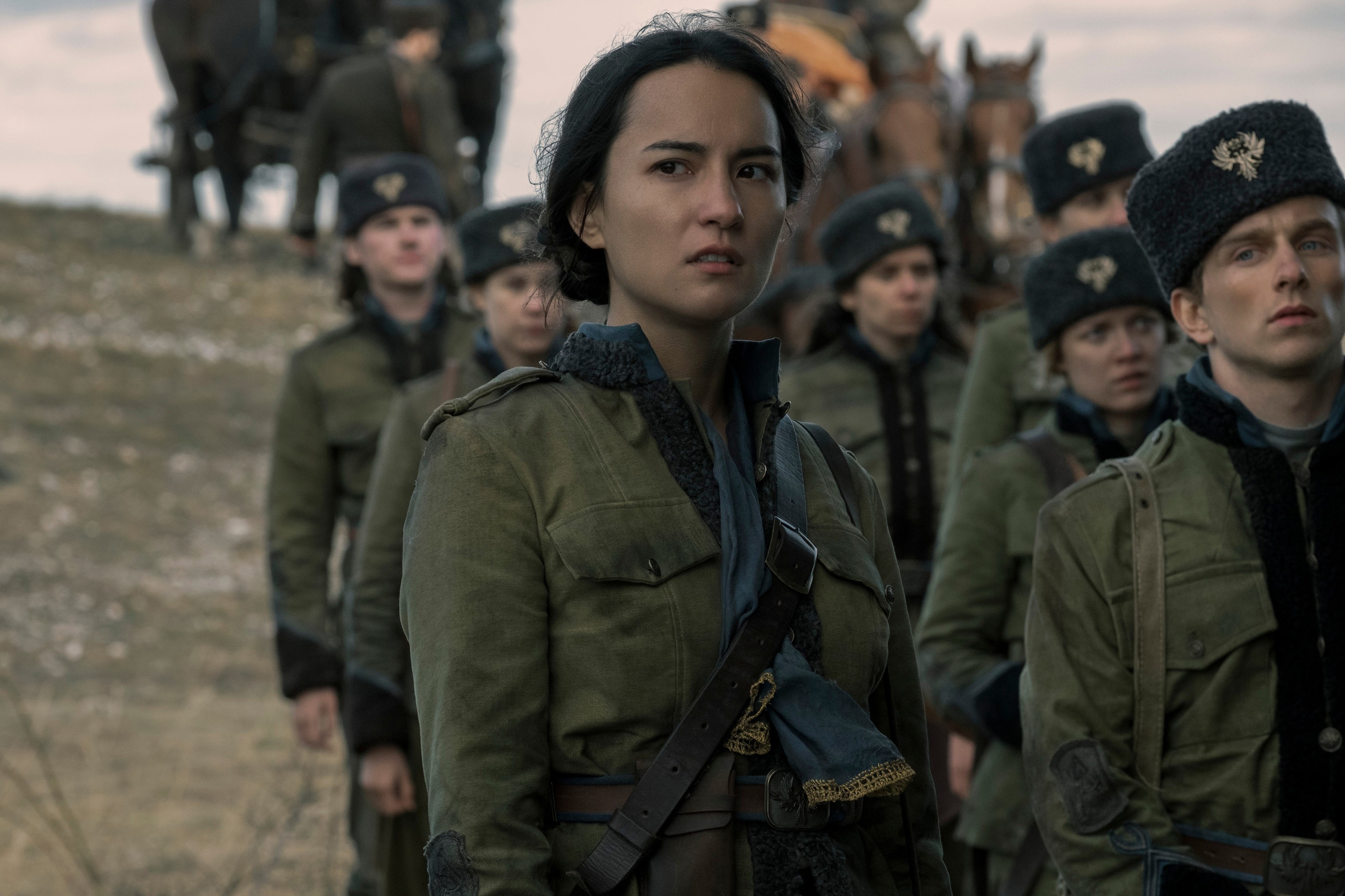 Alina wearing a jacket and standing with other soldiers