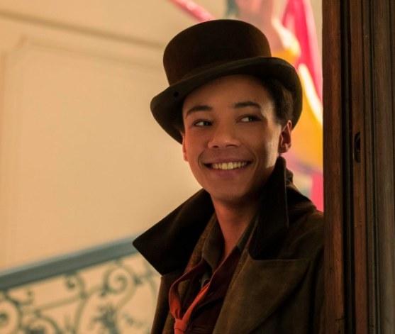Jesper stands in a doorway and smiles
