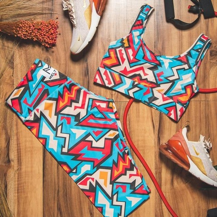 the same leggings paired next to a matching bra and sports sneakers