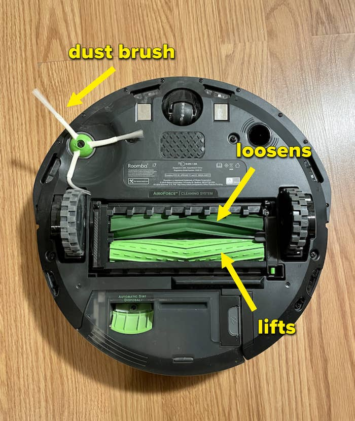 The underside of the Roomba i7+ where May labeled the dust brush and dirt loosening and lifting brushes