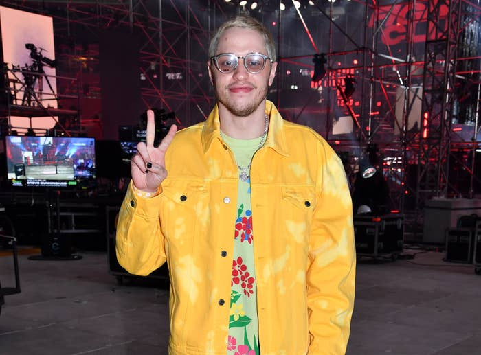 Pete gives a peace sign at the event