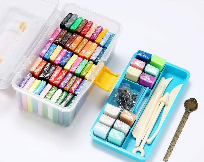 The clay set in a plastic case with compartments