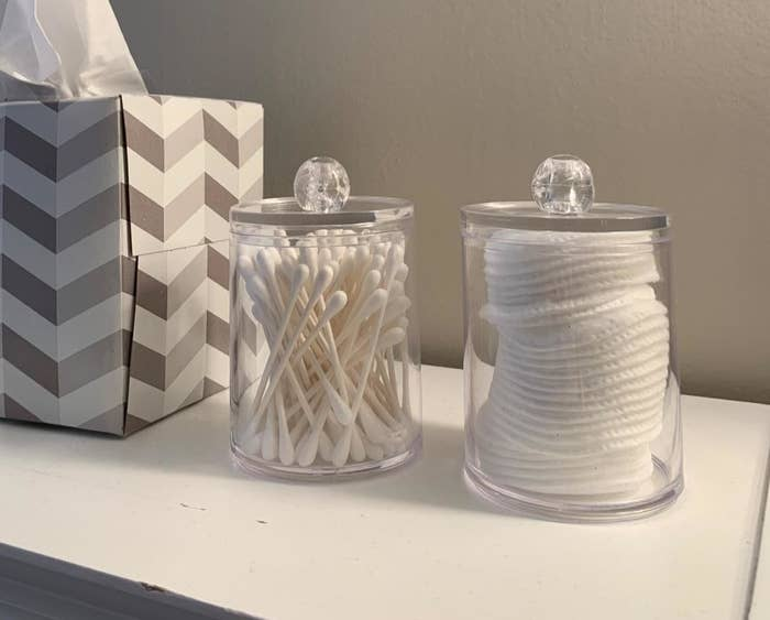 reviewer photo showing the two jars with q-tips in one and cotton rounds in the other