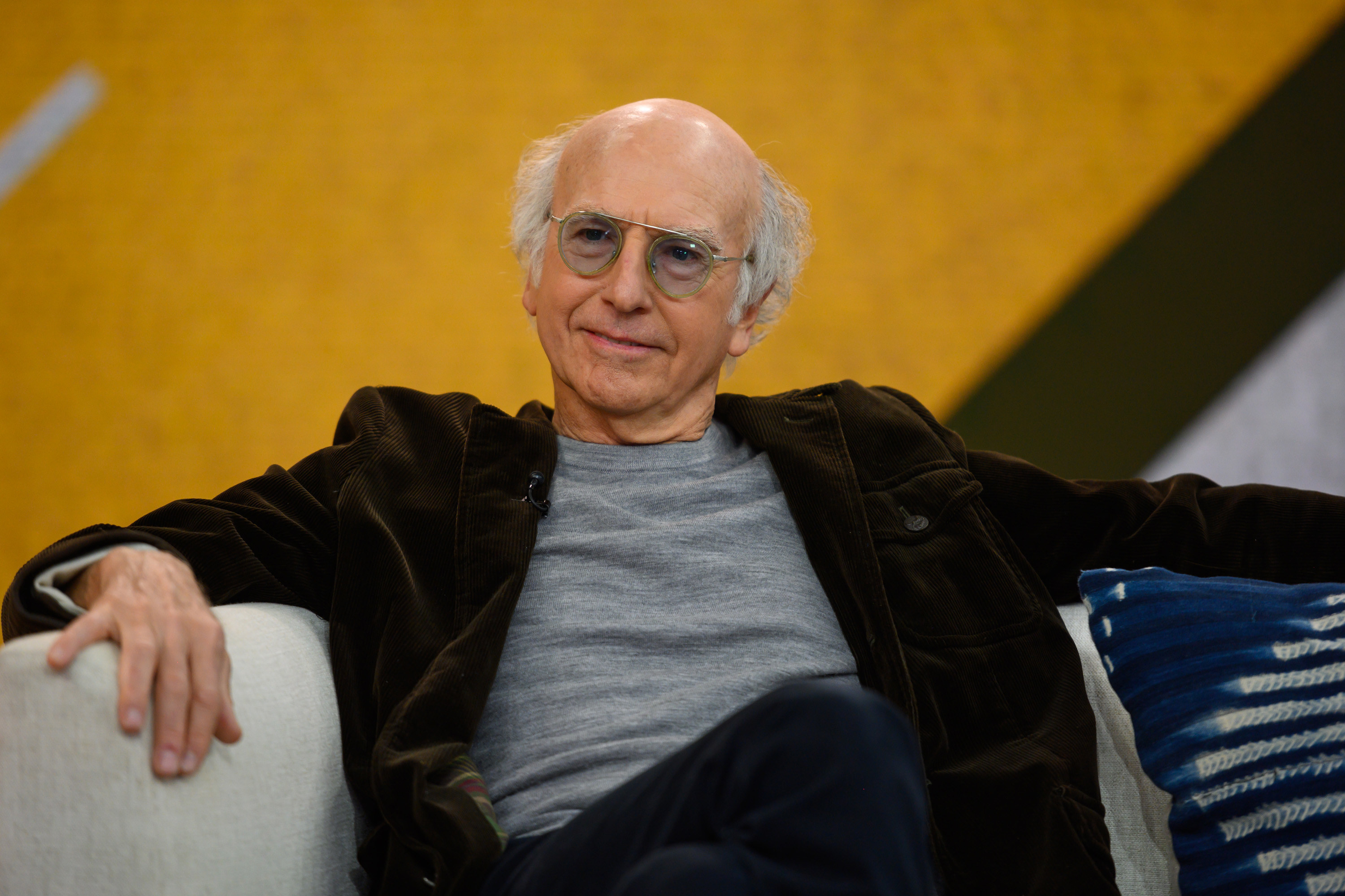 Larry David relaxing in a couch