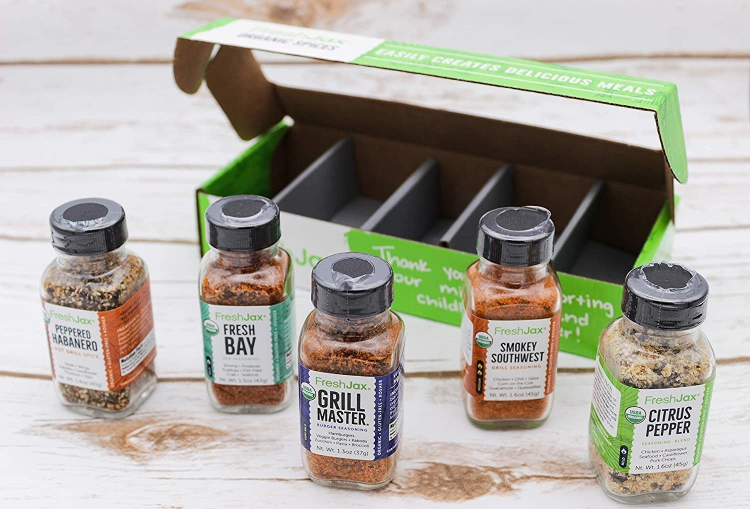 The grilling themed box, with five bottles of spices each labeled with their name and a short list of foods to try them on