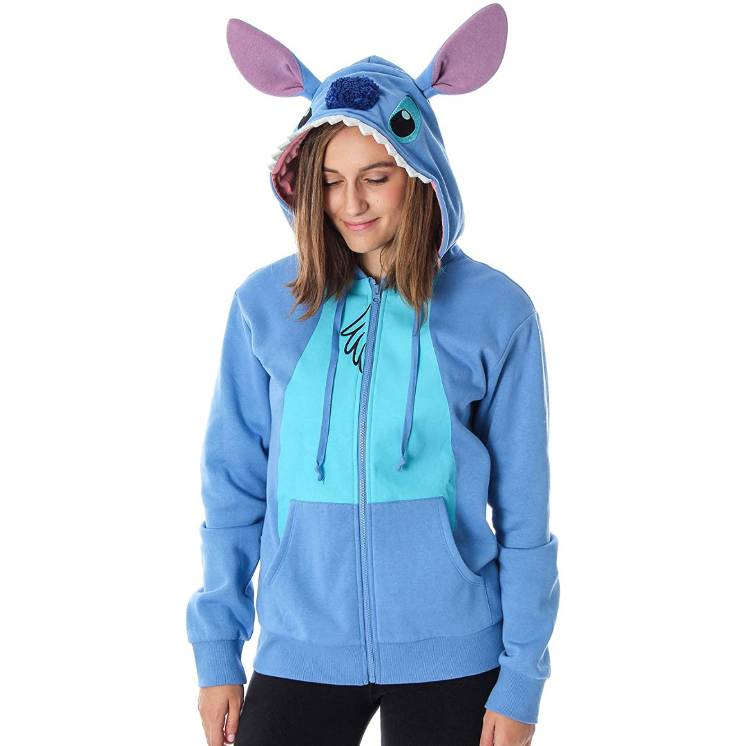 a model in a blue zip up with a hood with stitch ears attached