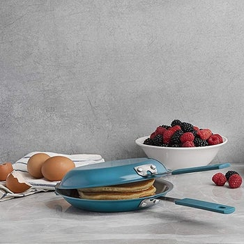 The teal hinged double pan with pancakes inside