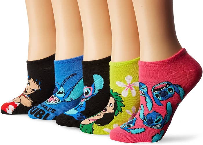 five pairs of socks with lilo and stitch patterns on them