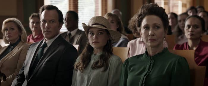 Ed and Lorraine Warren sitting in a court room with their daughter