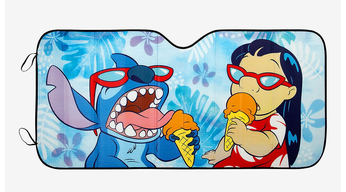 a car shade protector with stitch and lilo eating ice cream on it