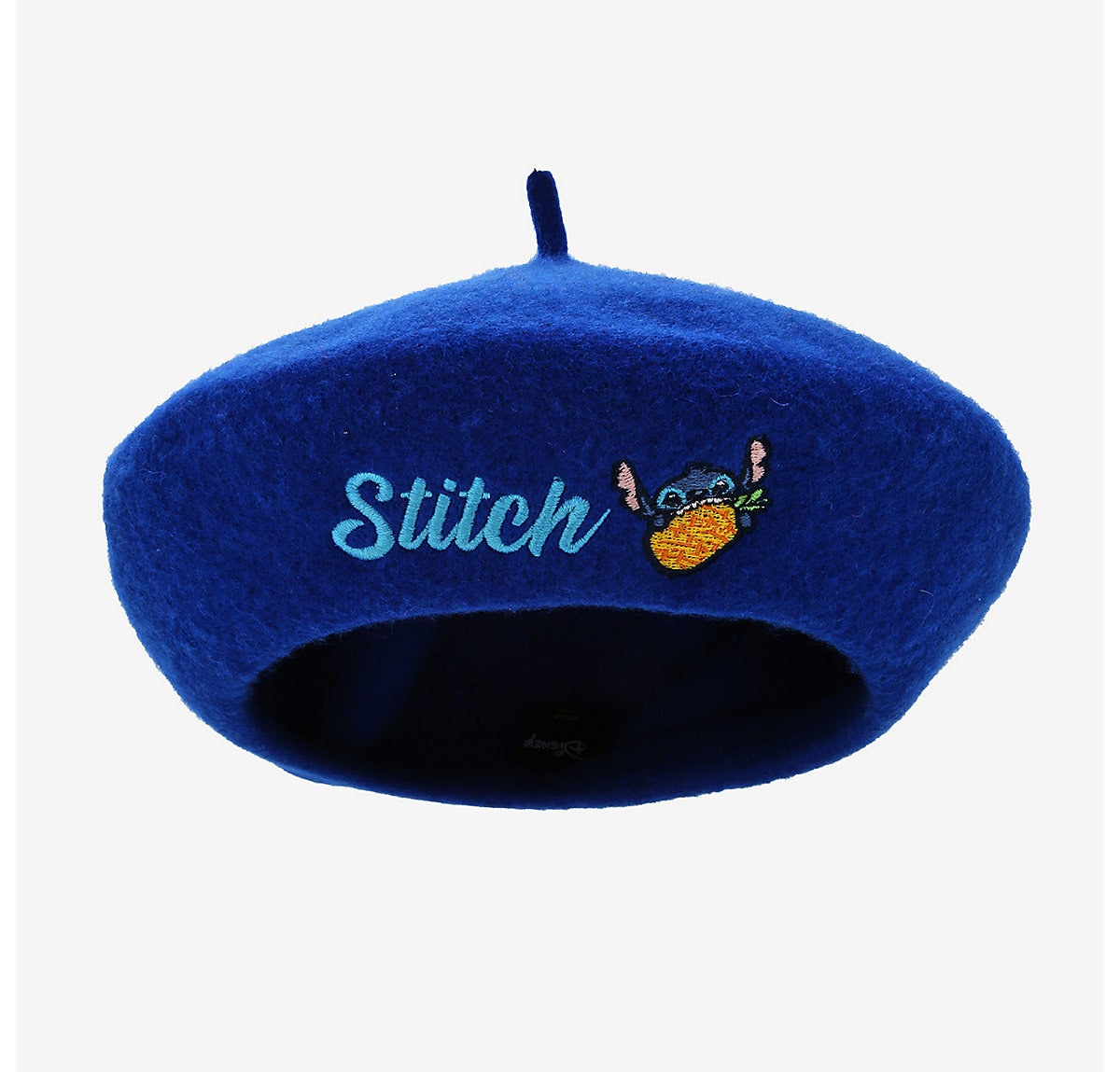 "a blue beret with the word ""stitch"" on it and stitch eating a pineapple"