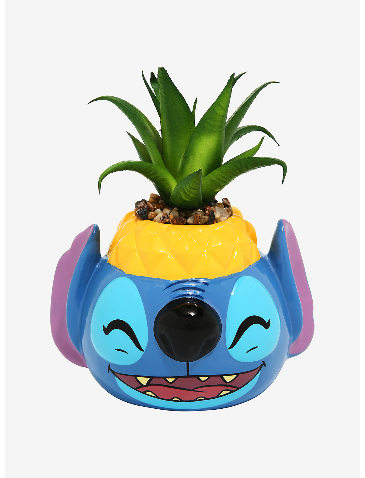 a smiling stitch planter with a pineapple at the top and a little sprout coming out of it