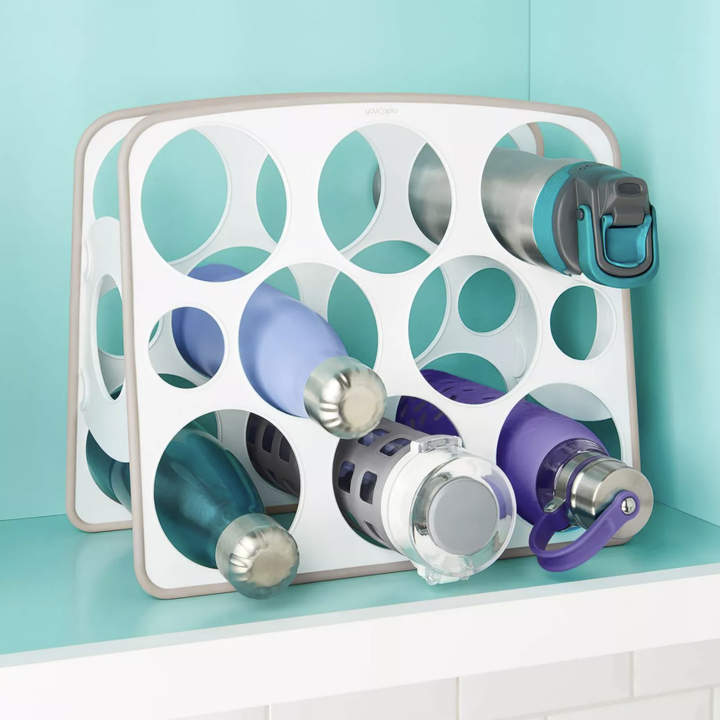 Water bottles placed in water bottle organizer