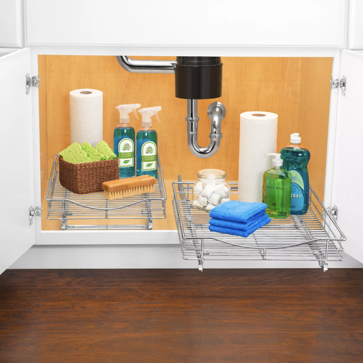 Sliding drawer placed in cabinet with kitchen items on top
