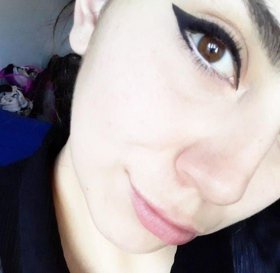 Reviewer wearing the bold winged eyeliner in black