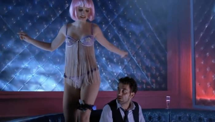 "Natalie Portman in a pink wig standing on top of a customer in ""Closer"""