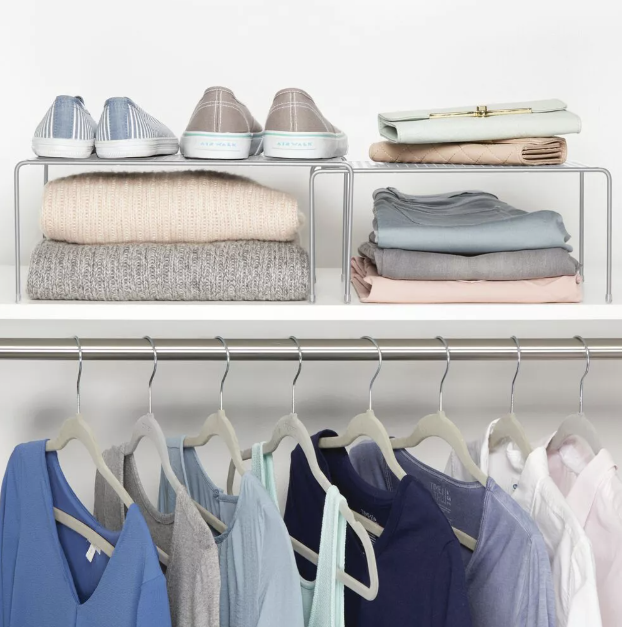 Two expandable shelves placed in closet
